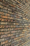 Sun glances off a brick wall with impressions giving it texture background. The afternoon sun glances off of a brick wall creating shadows that make the Stock Photos