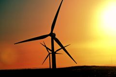 Sun glare upon Alberta windfarm Royalty Free Stock Photo