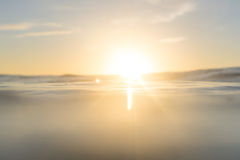 Sun glare. The sun beaming over the ocean Stock Image