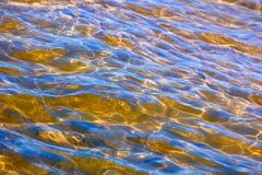 Sun glare on the sea water. Stock Photos