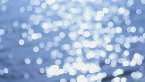 Sun glare on the water defocused with strong bokeh effect stock footage