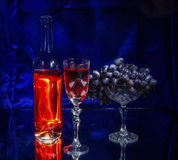 Sun in the Glass. Still life with red wine, grapes and a glass Stock Image