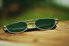 Sun Glass. Stylish Sun Glass picture on wood Royalty Free Stock Photos