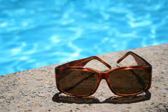 Sun glasses. By the pool Royalty Free Stock Images