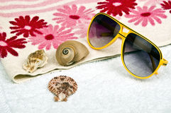 Sun glasses. On two towels Stock Image