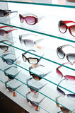 Sun glasses. Various of sun glasses at a shop with white background Royalty Free Stock Photo