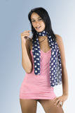 The sun glasses. Cute and sensual brunette wearing a red beach dress and blue foulard with white dot Stock Photos