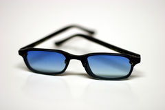 Sun glasses. Blue shaded sun glasses Royalty Free Stock Photography