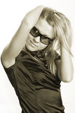 Sun glasses. Young girl in sexy dress on a white background. Shot in studio Stock Photo