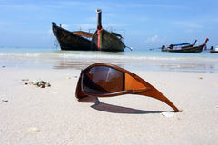 Sun-glasses on the beach Stock Images