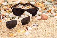 Sun glasses on the beach royalty free stock photo