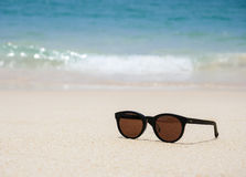 Sun glasses on the beach Summer Holiday background Royalty Free Stock Images