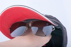 Sun glasses and a cap Royalty Free Stock Photo