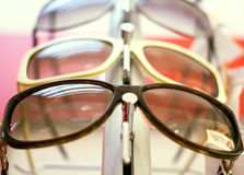 Sun glasses.close up shades and sunglasses in optician's shop Stock Photos