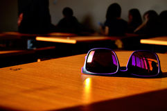 Sun glasses on the desk of the student summer Stock Photography