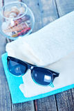 Sun glasses and flip flops. On wooden backgroubd stock photos