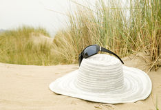 Sun glasses and hat on beach Royalty Free Stock Images