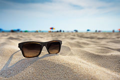 Sun glasses lie on a beach. stock image