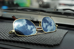 Sun glasses on mat Stock Image