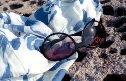 Sun glasses and pareo Stock Photos