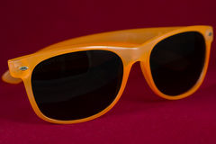 Sun glasses. Red sun glasses isolated over the red background Stock Photography