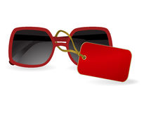 Sun glasses with a red label. eps10. Sun glasses with a red label. Vector illustration Royalty Free Stock Photography