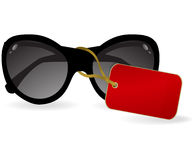 Sun glasses with a red label. eps10 Royalty Free Stock Photos