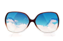 Sun-glasses with the reflections of the sky. Isolated on a white Royalty Free Stock Photography