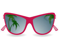 Sun glasses with reflexion of palm trees Royalty Free Stock Photo
