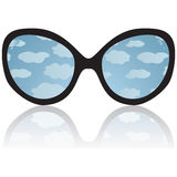 Sun glasses with reflexion of the sky and clouds Stock Photography