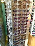 Sun glasses for sale outside a tourist shop. Holiday resort shop selling sunglasses Stock Photography