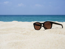 Sun glasses on Sand Beach Summer Holiday Travelling background Royalty Free Stock Photos