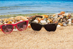 Sun glasses on the sea beach Royalty Free Stock Images