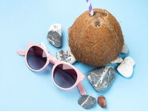 Sun glasses, sea stones and coconut Royalty Free Stock Images