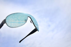 Sun glasses and sky Stock Images