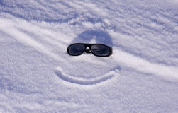 Sun glasses on snow Stock Photos