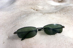 Sun Glasses in the snow Royalty Free Stock Photos