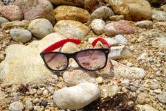 Sun glasses on the stone Stock Photo