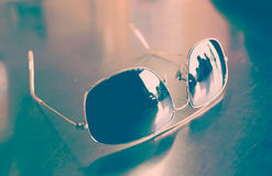 Sun glasses on wood table Stock Photography