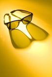 Sun Glasses on Yellow Background Stock Photo