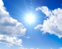 Sun is glowing between clouds stock image