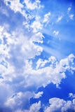 Sun glows in the laptop of cloud. In a Sunny midday Sun peeps bind the cloud - rays glowing inevery direction.concept of Purity ,freedom,etc Royalty Free Stock Photography