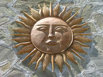 Sun God Against Stone. Mezo-American sun god against a pattern of stone Royalty Free Stock Image
