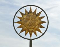 Sun God symbol. Closeup of sun God symbol with cloudscape background royalty free stock photos