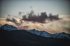 Snow mountain sunset cloud Silhouette stock image