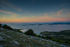 Sun goes down over Croatian islands royalty free stock image