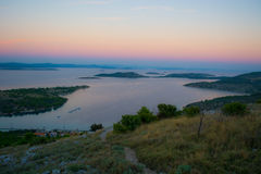 Sun goes down over Croatian islands royalty free stock photography