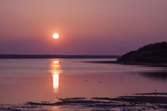 The sun goes down over the East Fleet in Dorset Stock Photography