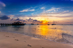 Sun goes down over Palm Beach, Aruba Stock Photography