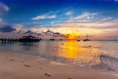 Sun goes down over Palm Beach, Aruba stock photography